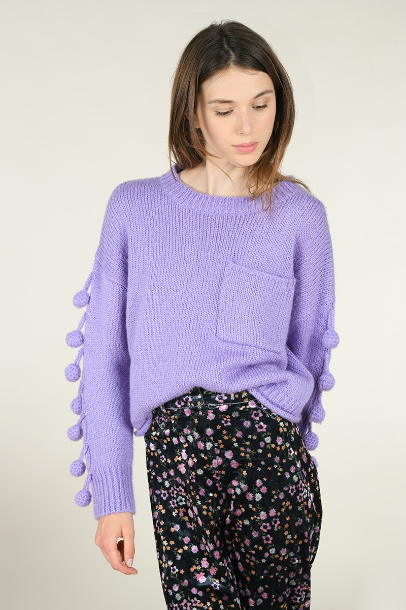 Knitted jumper and pompom